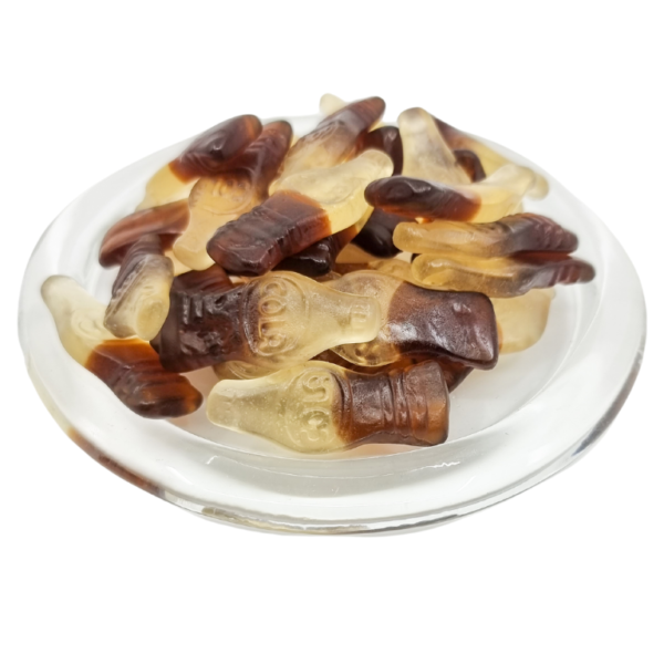 Cola bottle lollies on a clear plate